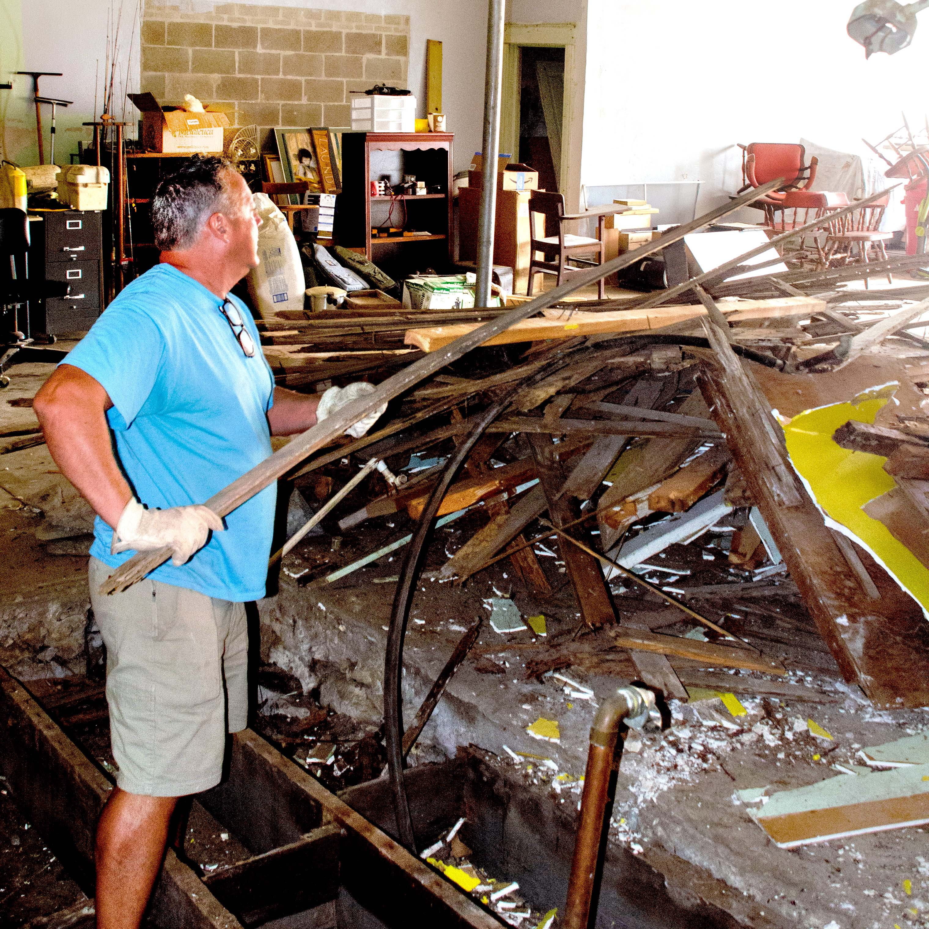 While Josh Fistler smears sauce on a homemade crust, volunteers Jay Gfeller and Larry Watts put toppings on the pizzas Friday at American Legion pizza night.